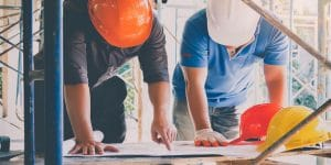 Development-engineer-discussing-foreman-about-project-building-300x150.jpg