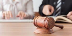 Dispute-Resolution-judge-gavel-lawyers-having-team-meeting-300x150.jpg