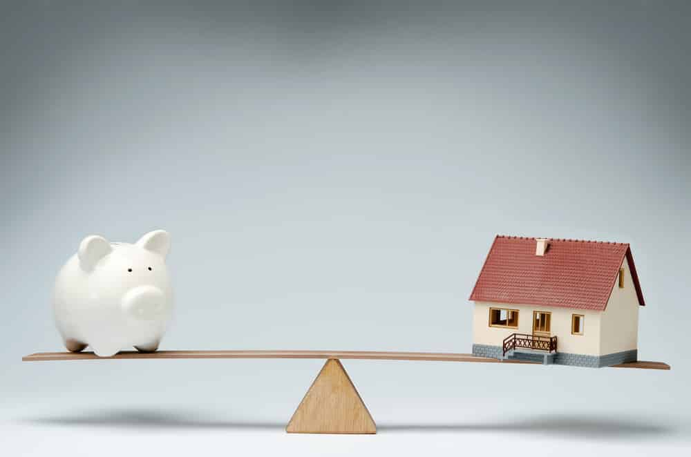 piggy bank and property balance